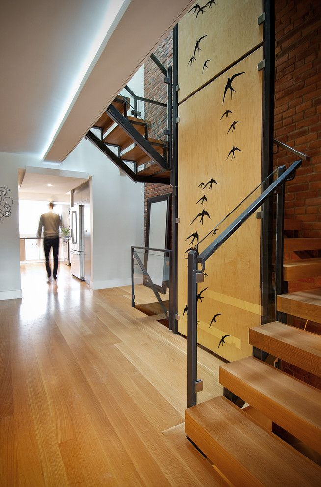 Cumtv for a Modern Staircase with a Open Risers and Oak + Steel Staircase by Roundabout Studio Inc.