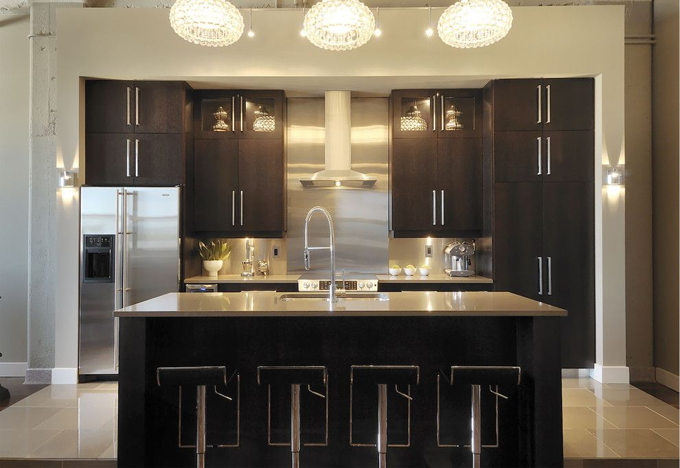 D Lawless Hardware for a Contemporary Kitchen with a Stainless Steel Appliances and T Eatons Kitchen by Atmosphere Interior Design Inc.