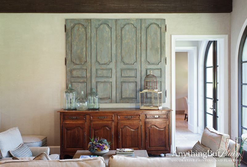 David Weekley Homes Houston for a Mediterranean Family Room with a Sofa and Hidden Television with Faux Antique Panels by Anything but Plain, Inc.