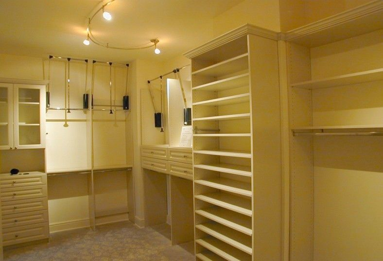 David Weekley Homes Houston for a Traditional Closet with a Dream Closet and Custom Closet Ideas and Features by Spaceman Home & Office