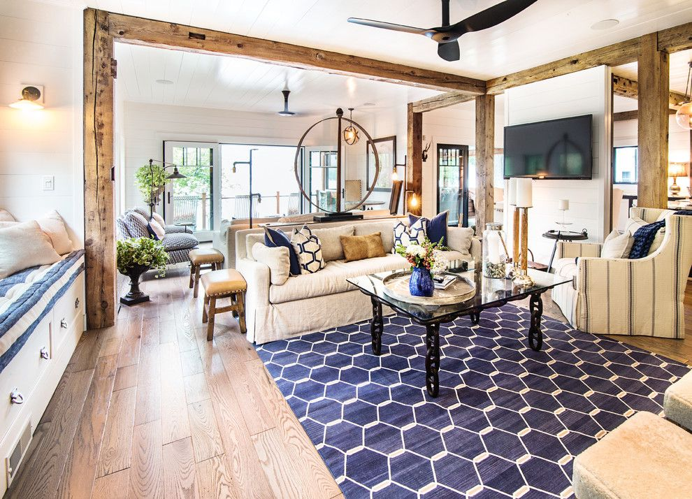Davids Furniture for a Rustic Living Room with a Exposed Beams and Lake George Retreat by Phinney Design Group