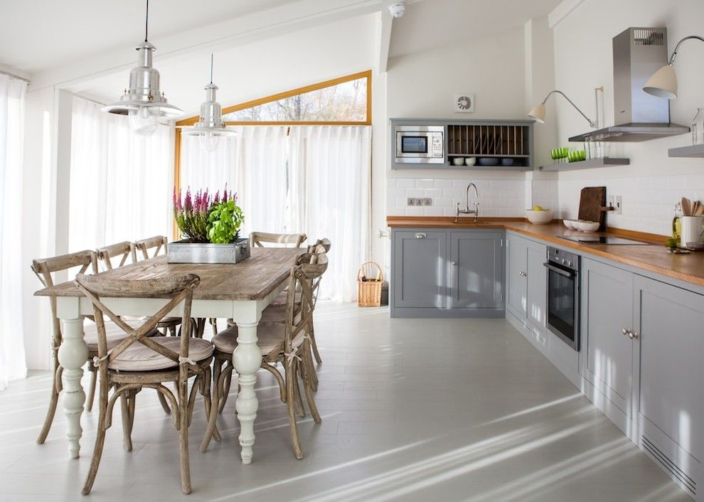 Decluttering for a Farmhouse Kitchen with a Bridge Faucet and Seaside Farmhouse by Gabriel Holland Interior Design