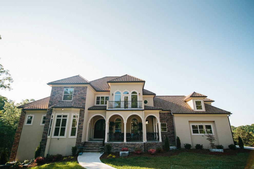 Decra for a Modern Exterior with a Decra Roof and Decra Roof by Green Form Construction, Inc.