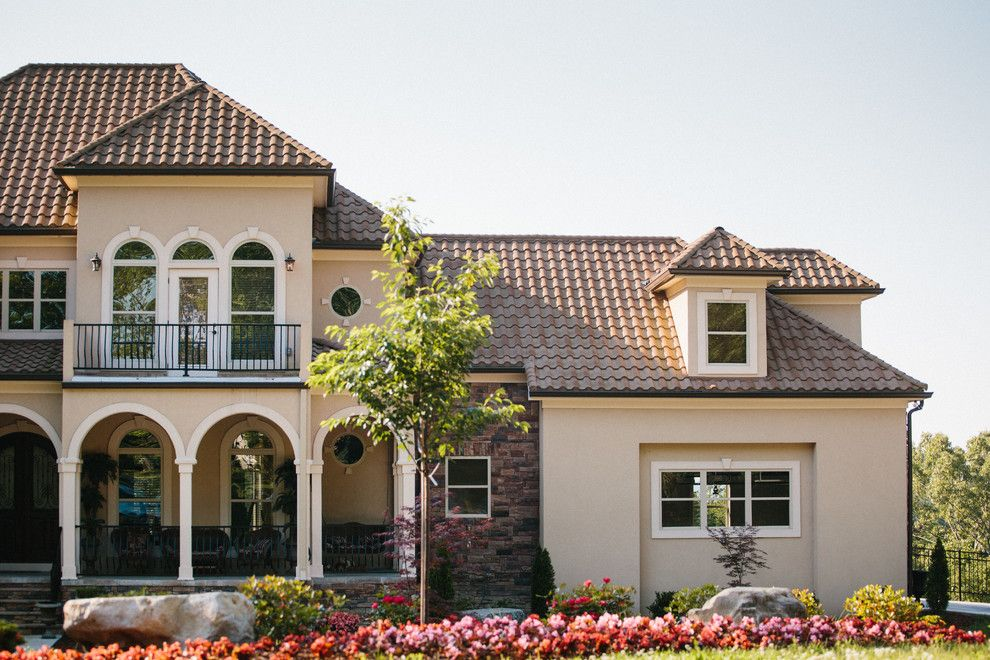 Decra for a Modern Exterior with a Spanish Tile and Decra Roof by Green Form Construction, Inc.