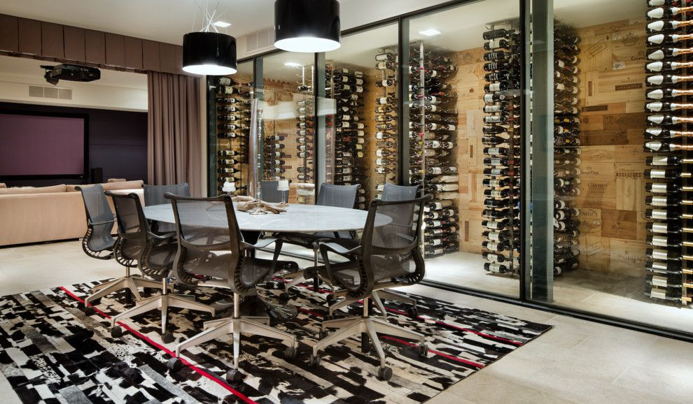 Del Monte Theater for a Contemporary Wine Cellar with a Dining Room and Cascading Creek House by Spencer Construction Llc.