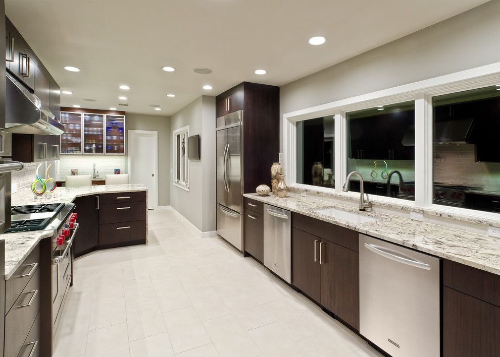 Delicatus Granite for a Contemporary Kitchen with a Countertop and Buckingham by Jay Rambo Co.
