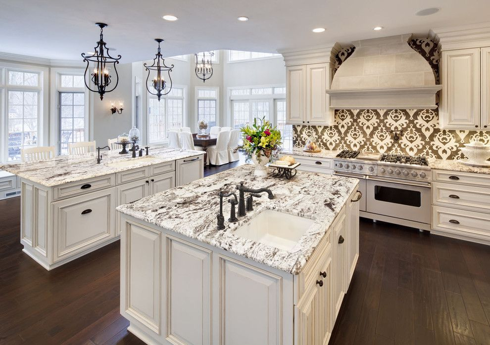 Delicatus Granite for a Traditional Kitchen with a White Kitchen and Kitchen by Kanncept Design, Inc.