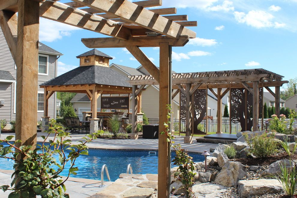 Delicatus White Granite for a Rustic Patio with a Hemlock and Outdoor Oasis by Flatbrook & Co