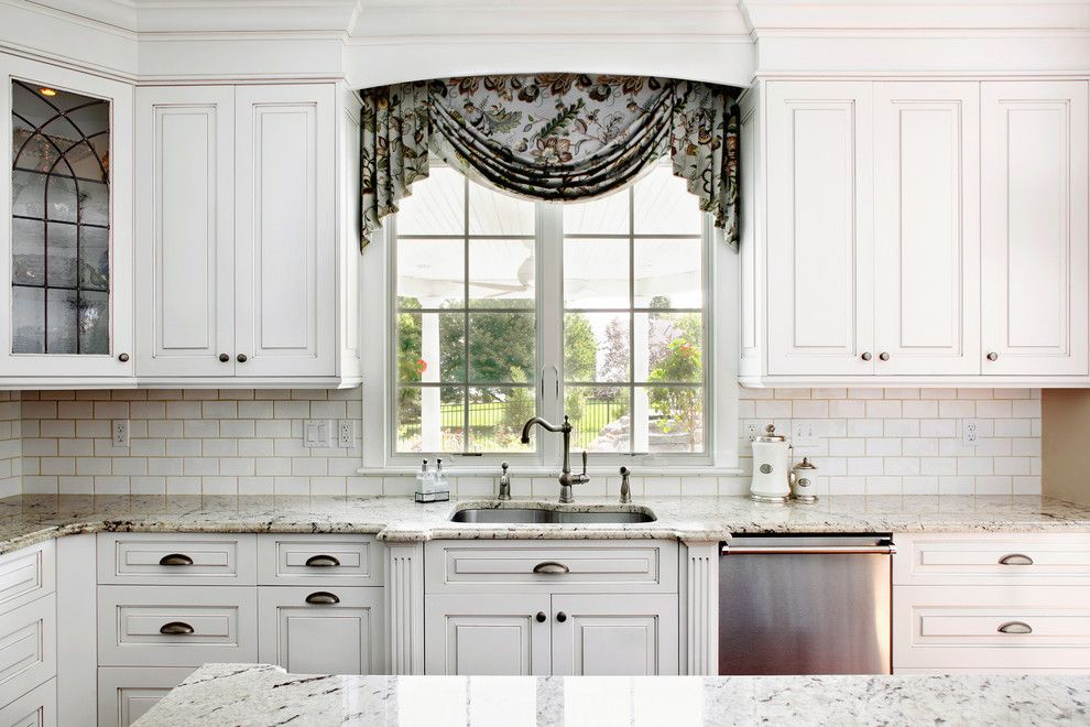 Delicatus White Granite for a Traditional Kitchen with a Exhaust Hood and Magnolia Way Kitchen by Sullivan Building & Design Group