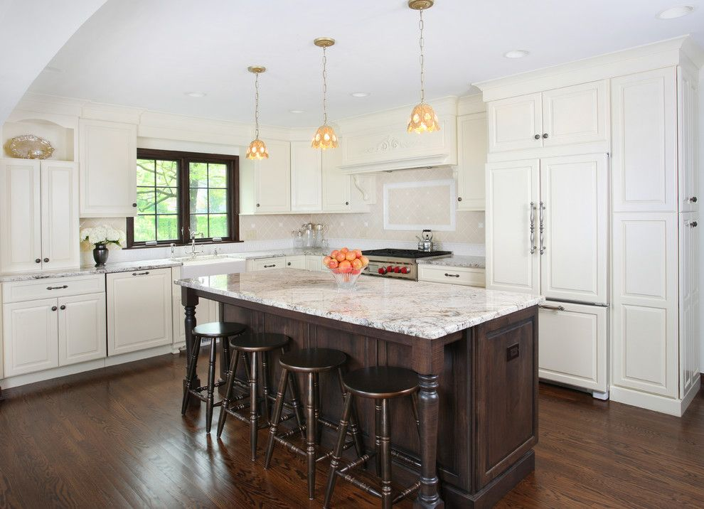 Delicatus White Granite for a Tropical Kitchen with a Stained Island and Vintage Kitchen in Tudor Style Home by Normandy Remodeling