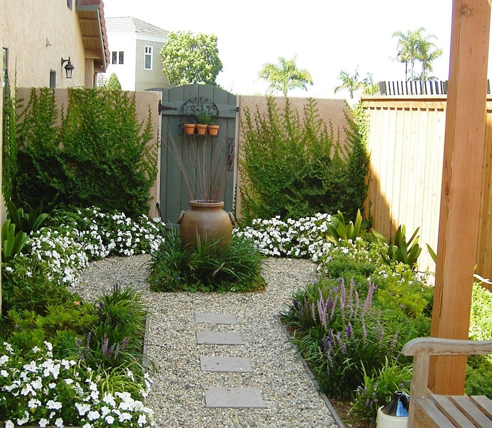 Desert Landscaping Ideas for a Mediterranean Landscape with a Wood Fence and Debora Carl Landscape Design by Debora Carl Landscape Design