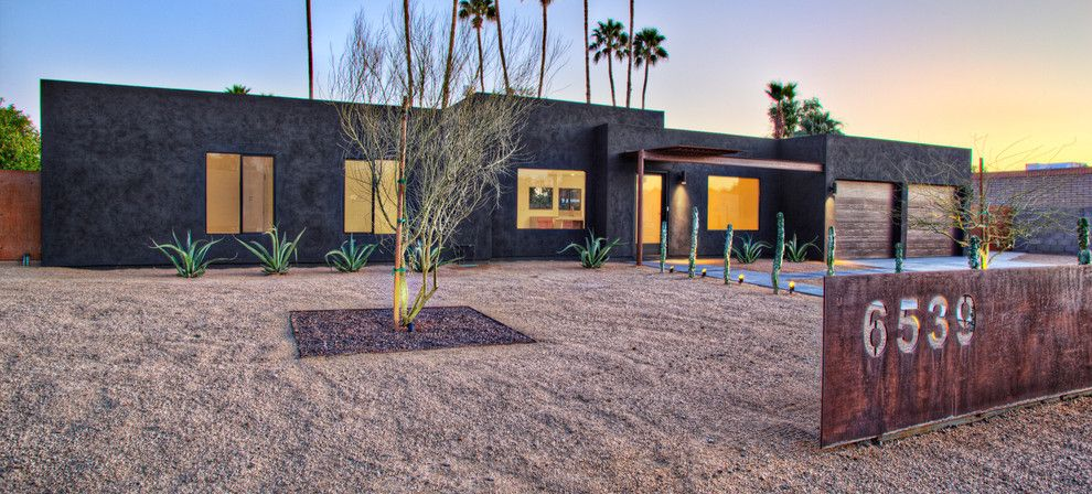 Desert Landscaping Ideas for a Southwestern Exterior with a Cacti and Black House (Steinman Renovation) by Spry Architecture