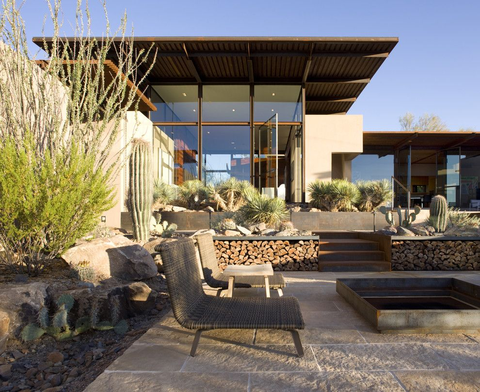 Desert Landscaping Ideas for a Southwestern Patio with a Sonoran Desert Courtyard and the Brown Residence by the Construction Zone, Ltd.