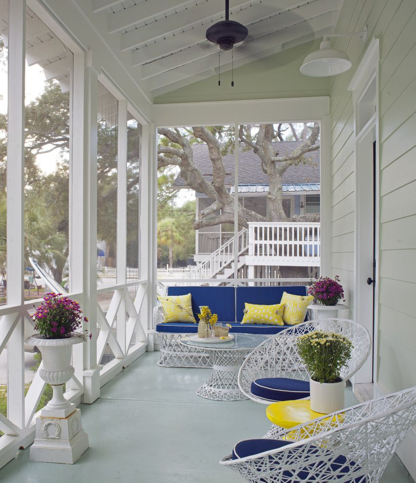 Dewey Furniture for a Beach Style Porch with a Savannah and Porch by Rethink Design Studio