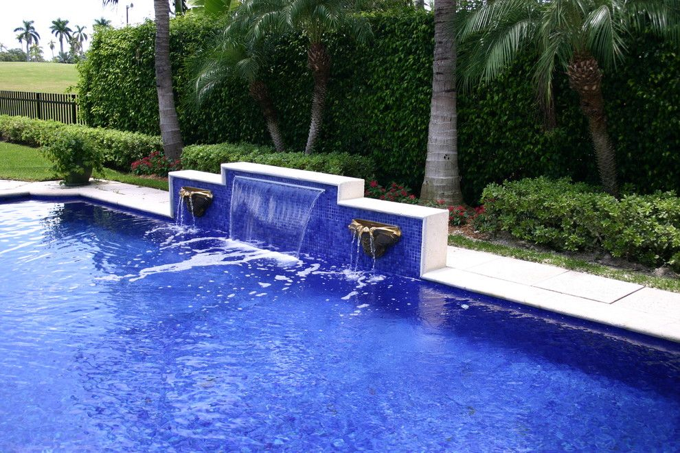 Diamond Brite for a Eclectic Pool with a Infinity Pool and Glass Tile Waterfall by Foreverpools