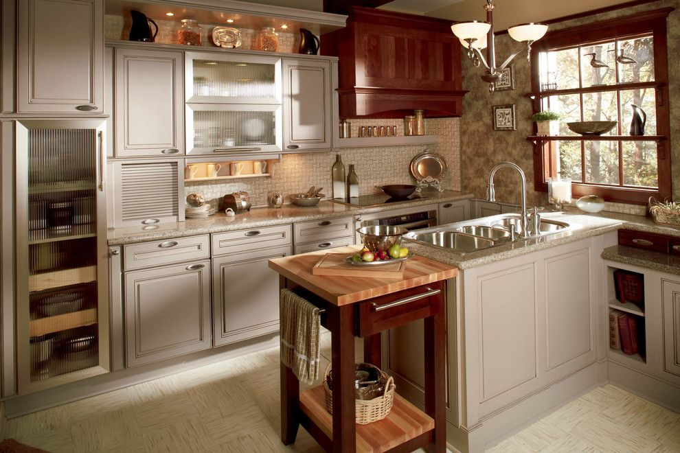 Discover Marble and Granite for a Traditional Kitchen with a Chandelier and Wellborn Cabinet by Wellborn Cabinet, Inc.