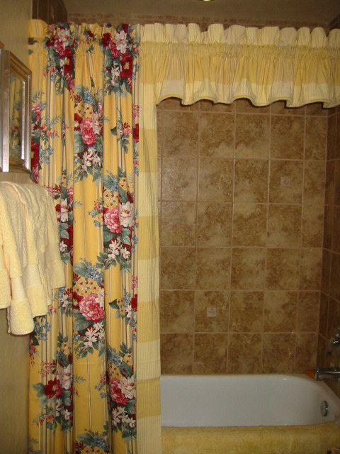 Distinctive Fabrics for a Traditional Spaces with a Valance and Stationary Panel for a Bath and Arizona Project by Designs of Distinction