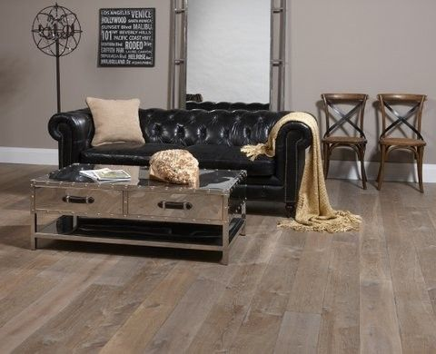 Distressing Wood for a Eclectic Living Room with a Tufted Black Sofa and Northern Wide Plank   Shades of Gray and Black by Michelle Finnamore Interiors Ltd.