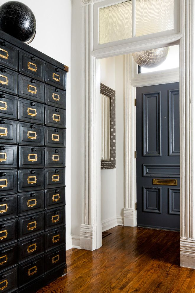 Doerr Furniture for a Victorian Entry with a Wood Floor and Victorian Home by Toronto Interior Design Group | Yanic Simard