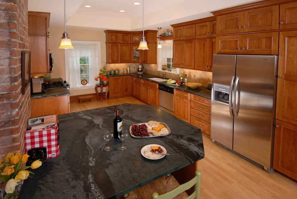 Domicile Furniture for a Traditional Kitchen with a Peninsula and Italian Inspired Kitchen by Bella Domicile