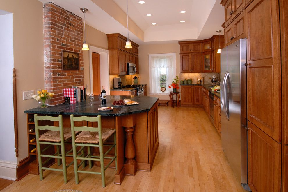 Domicile Furniture for a Traditional Kitchen with a Stainless Appliances and Italian Inspired Kitchen by Bella Domicile