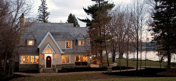 Dormer Windows for a Traditional Exterior with a Stone Chimney and Exterior by John Kraemer & Sons