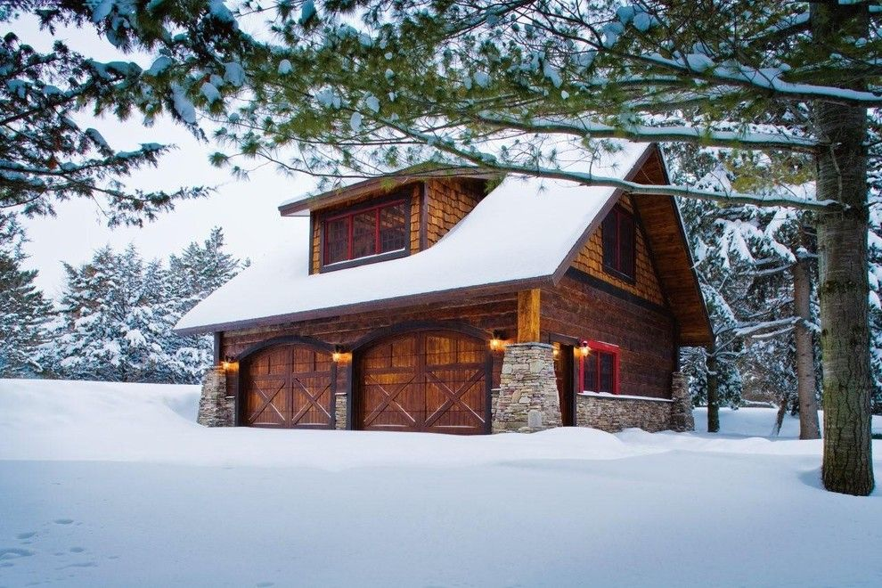 Dormers for a Rustic Garage with a Attic Storage and Carriage House   Lower Whitefish Lake 1   Winter by Lands End Development   Designers & Builders