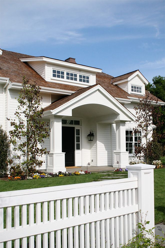 Dormers for a Traditional Exterior with a Custom Fence and Featured Projects by Duxbury Architects
