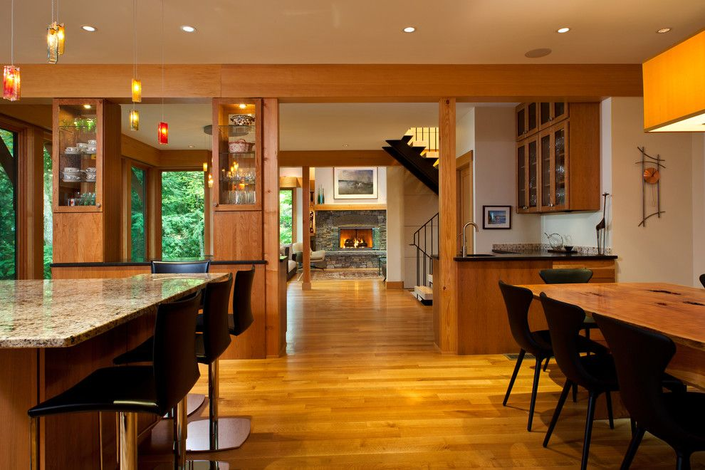 Dorn Homes for a Contemporary Entry with a Fireplace and Lake Luzerne House by Phinney Design Group