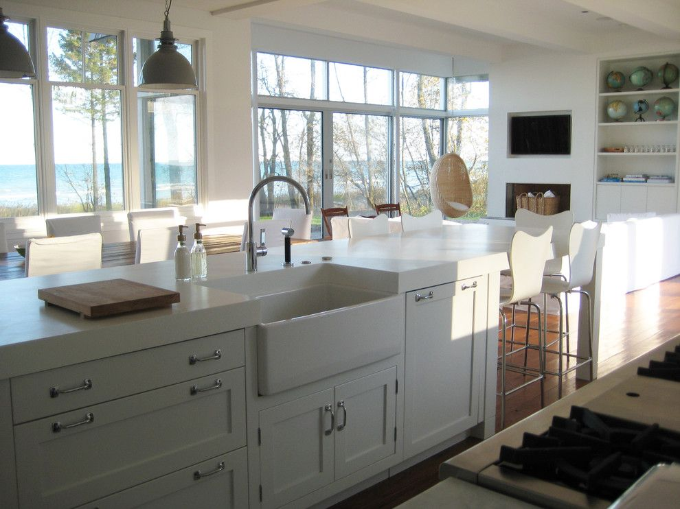Dornbracht for a Beach Style Kitchen with a Eat in Kitchen and Kitchen by Searl Lamaster Howe Architects