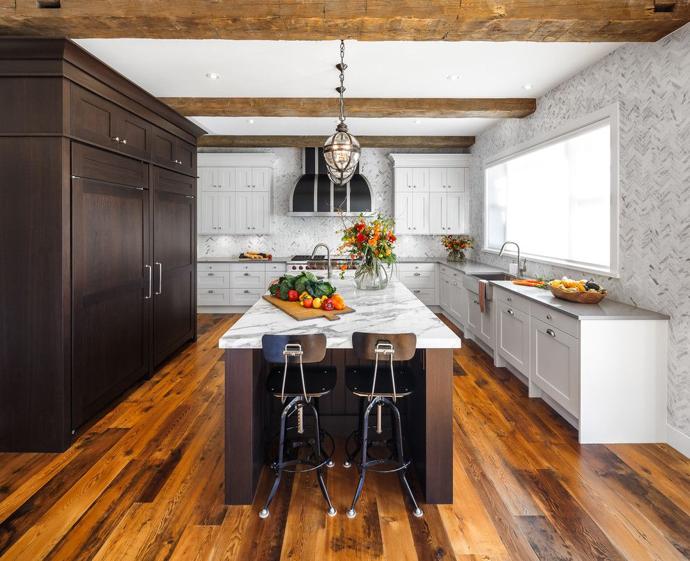 Downsview Kitchens for a Traditional Kitchen with a Marble Backsplash and Rough Luxe Residence   Ottawa   Astro Design Centre by Astro Design Centre