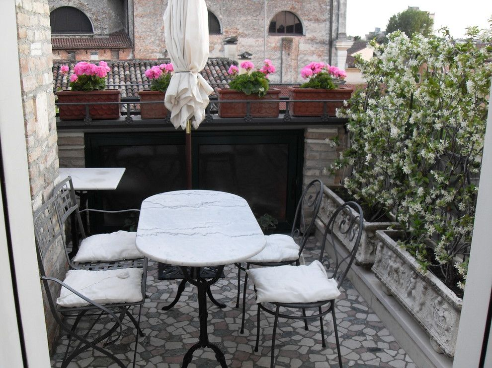 Dox Furniture for a Mediterranean Patio with a Marble Table and Alice's House by Alice Masin