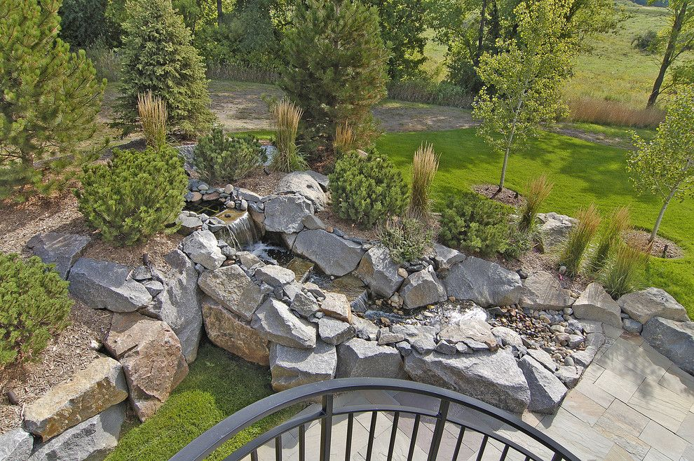 Drainage Ditch for a Traditional Landscape with a Traditional and Outdoor Water Feature by John Kraemer & Sons