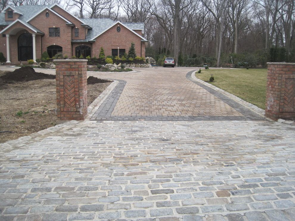 Driveway Apron for a Traditional Exterior with a Cobblestone Apron and Driveway Aprons by Legacy Brick & Stone