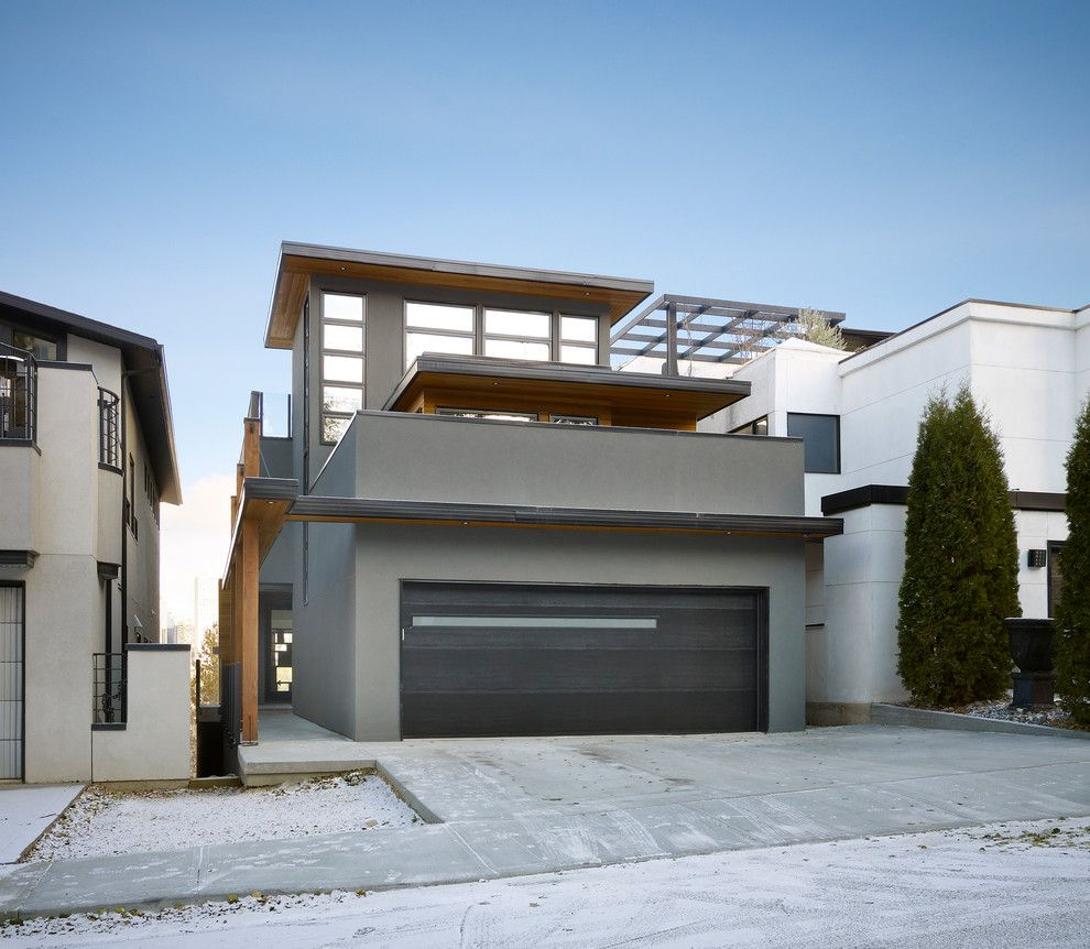 Dryvit for a Contemporary Exterior with a Garage and Paragon by Habitat Studio