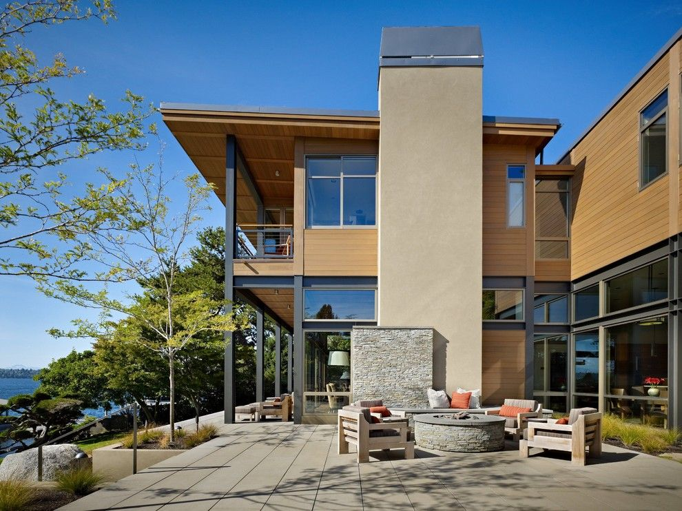Dryvit for a Modern Patio with a Stone Chimney and Lake House Two   Patio by Mcclellan Architects