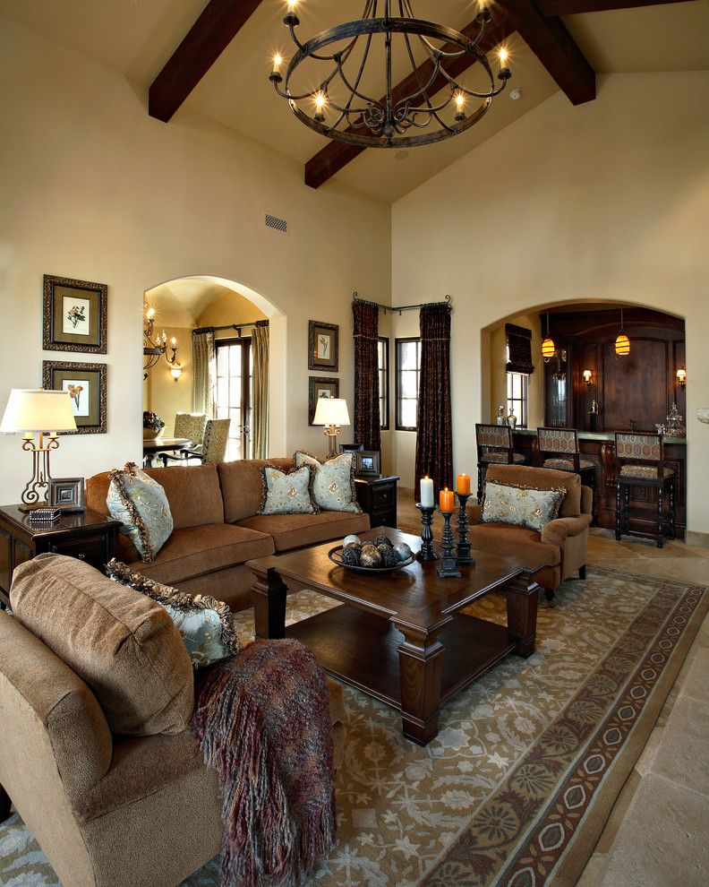 Dunn Edwards Swiss Coffee for a Mediterranean Living Room with a Brown Sofa and Superstition Mountain Traditional by Linda Seeger Interior Design