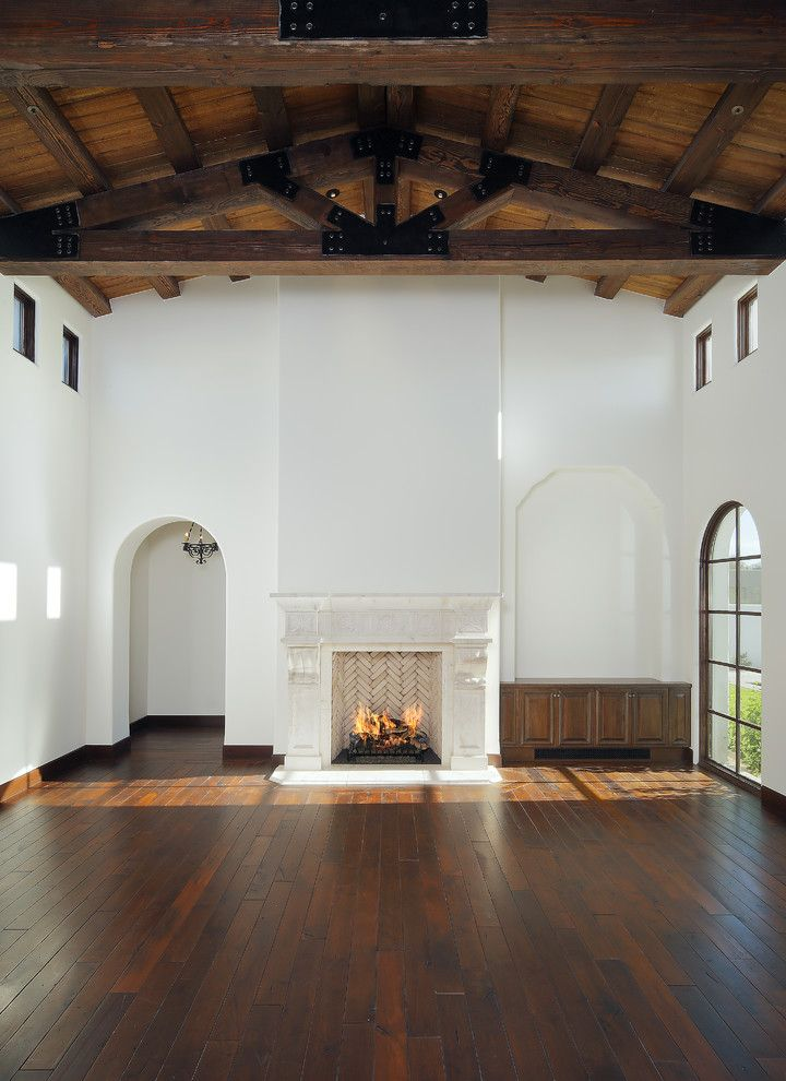 Dunn Edwards Swiss Coffee for a Rustic Family Room with a Fireplace Mantel and Carson Poetzl, Inc. by Carson Poetzl, Inc.