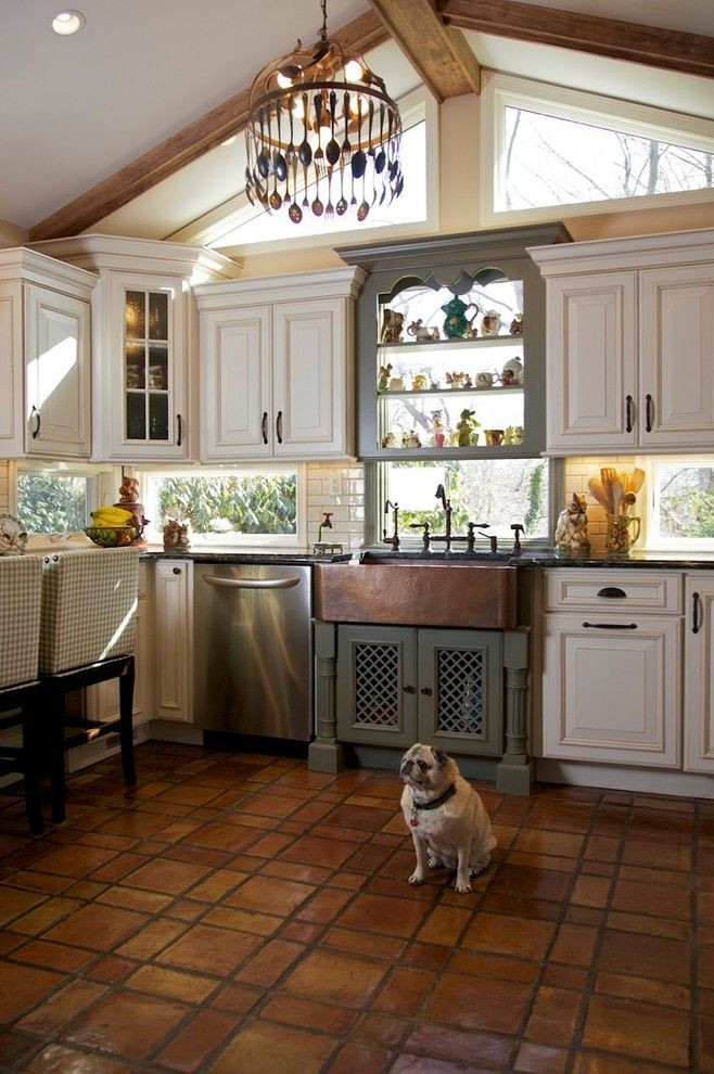 Dura Supreme Cabinets for a Rustic Kitchen with a Terra Cotta and Tri Color Kitchen by Merri Interiors, Inc.