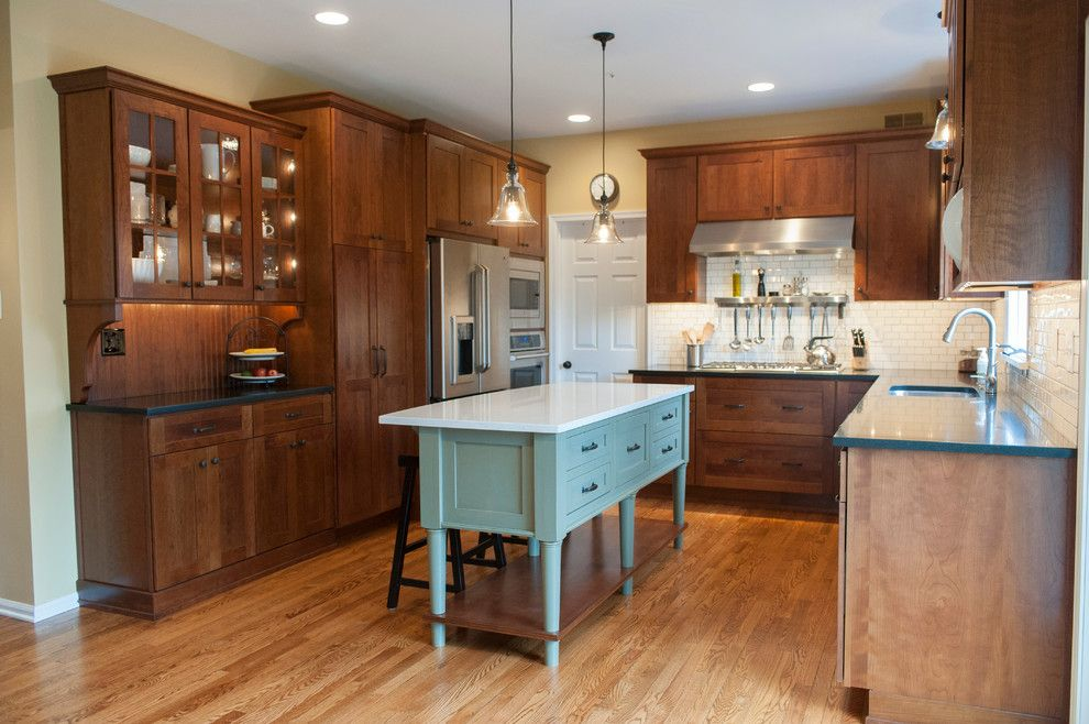 Dura Supreme for a Craftsman Kitchen with a Contrasting Cabinets and West Chester Kitchen Featuring Dura Supreme Craftsman Panel Door by Pine Street Carpenters & the Kitchen Studio