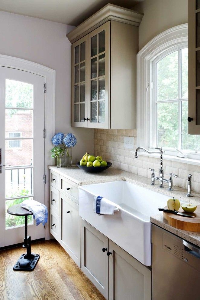 Durango Doors for a Traditional Kitchen with a Farmhouse Sink and Row House Kitchen Remodel by Wentworth, Inc.