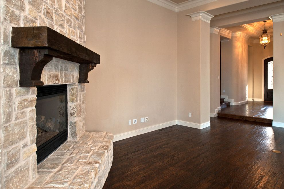 Duraseal Stain for a Traditional Family Room with a Cedar Mantel and Audubon by Joseph Paul Homes
