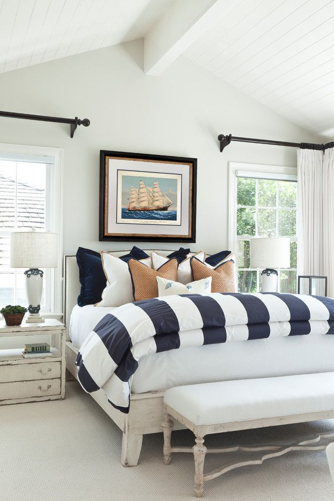 Duvet Definition for a Beach Style Bedroom with a Cathedral Ceiling and Traditional Beach | Ocean Boulevard by Barclay Butera Interiors