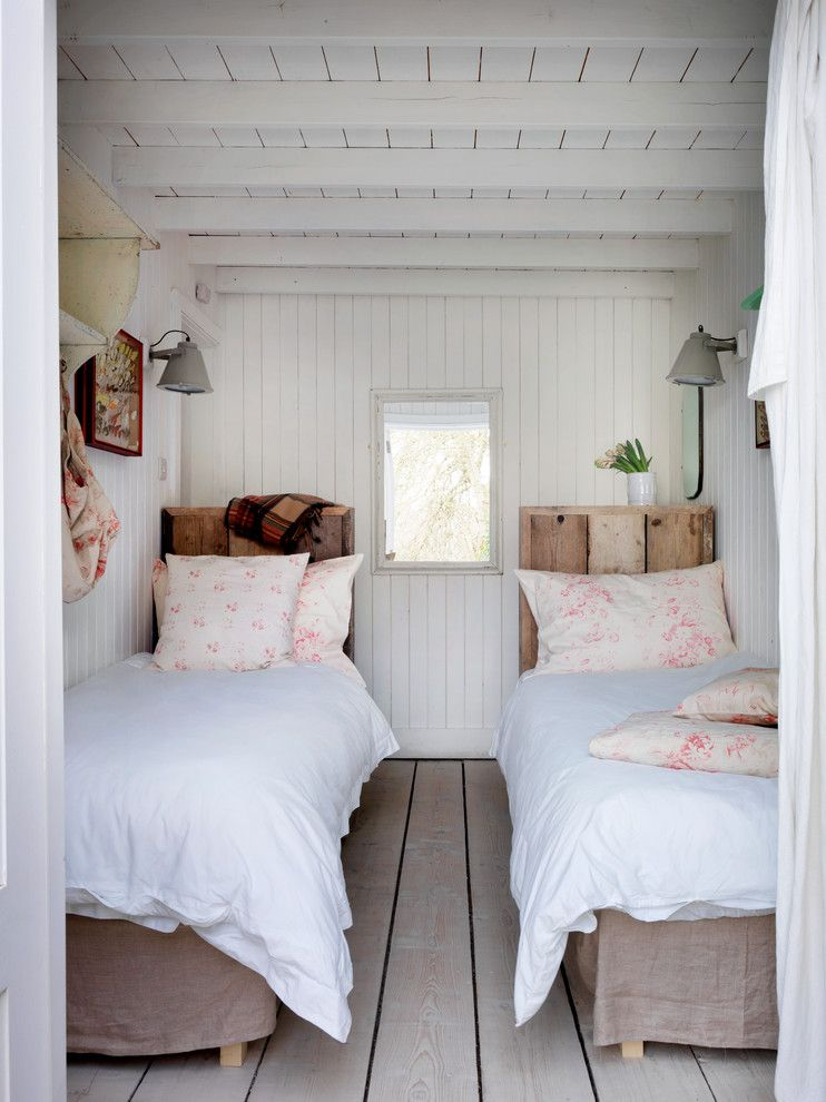 Duvet vs Comforter for a Beach Style Bedroom with a White Beams and Winchelsea Beach by Cabbages & Roses Ltd