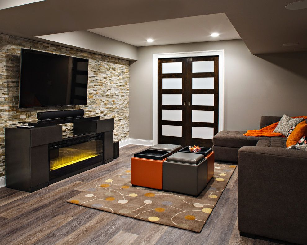 Dykes Lumber for a Contemporary Family Room with a Wine Rack and Innovative Inspiration by Creative Design Construction, Inc.