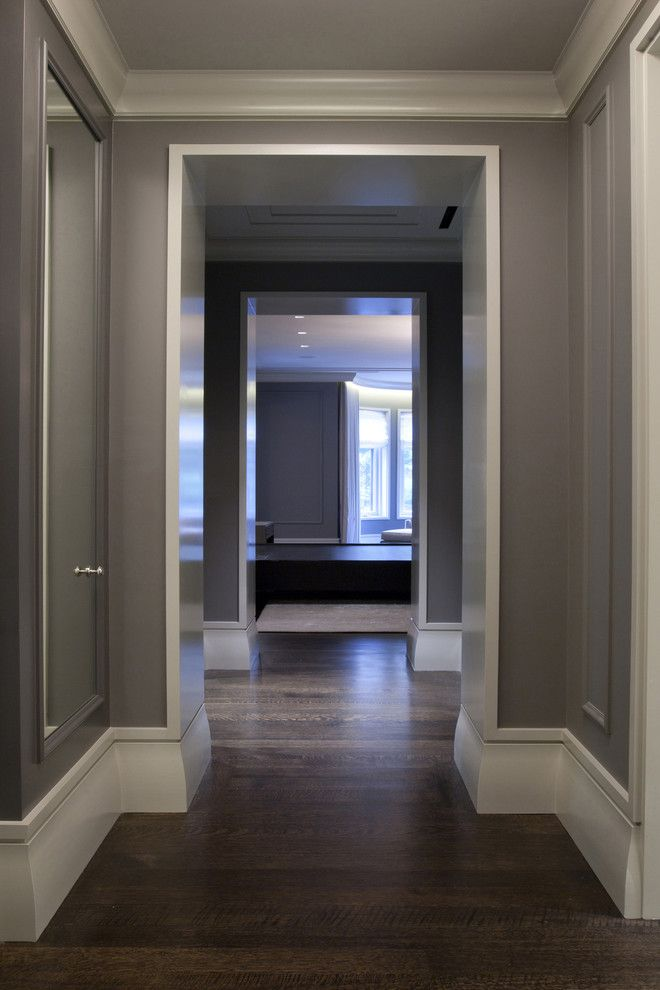 Eggshell vs Satin for a Contemporary Hall with a Baseboard and Master Hall by Dspace Studio Ltd, Aia