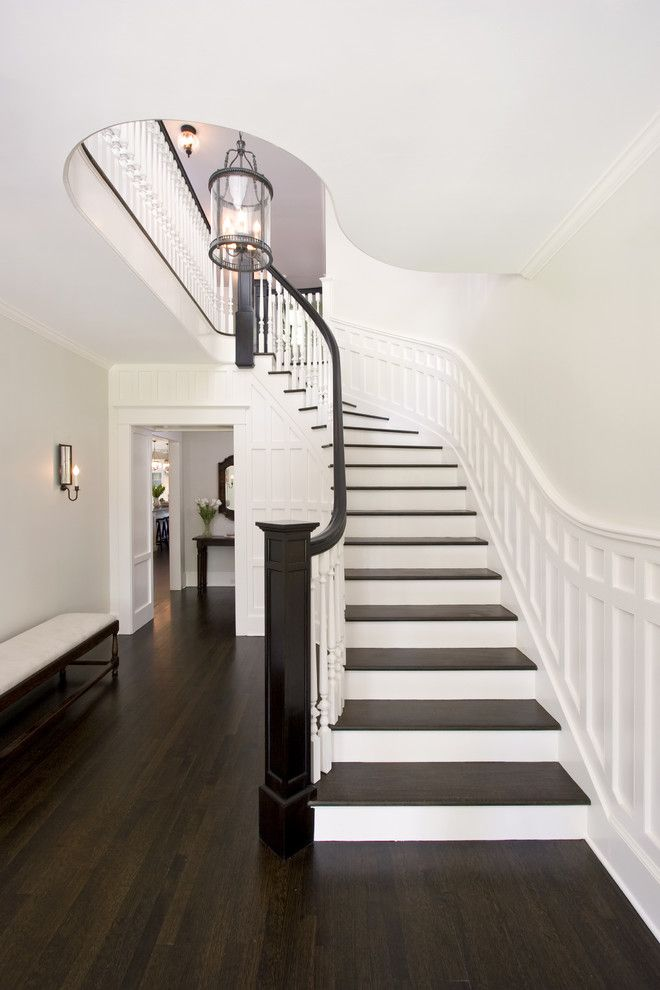 Eggshell vs Satin for a Traditional Staircase with a Wood Railing and Award Winning Curving Stair by Clawson Architects, Llc