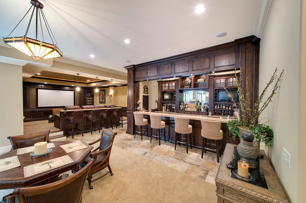 Elk Grove Theater for a Traditional Basement with a Dark Wood Dining Chair and Traditional Basement by Hbdbuilder.com