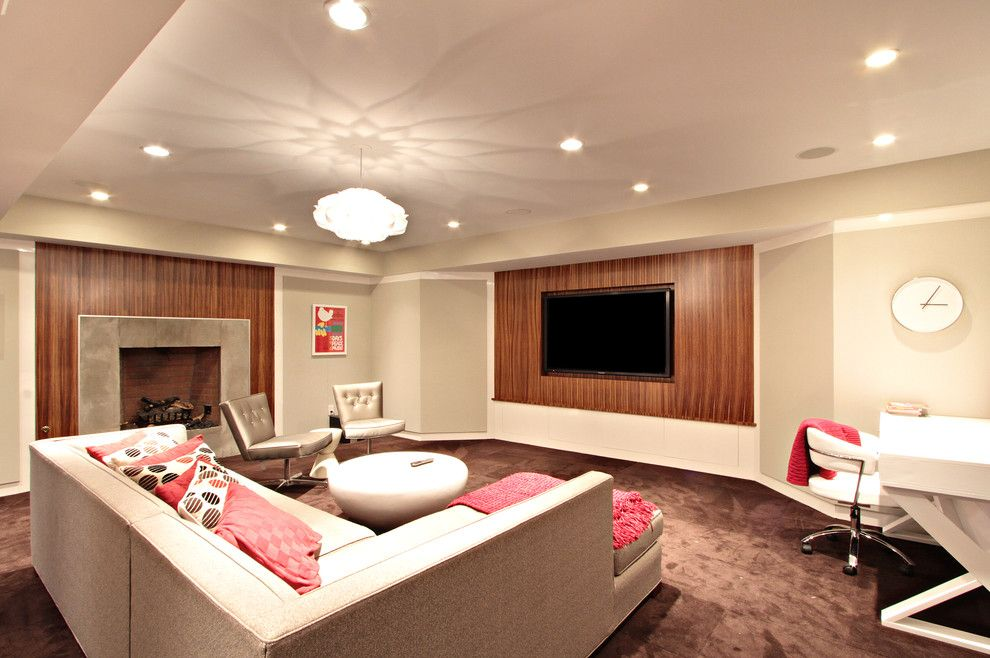 Elk River Theater for a Contemporary Basement with a White Clock and Random Work by D.a.s. Custom Builders