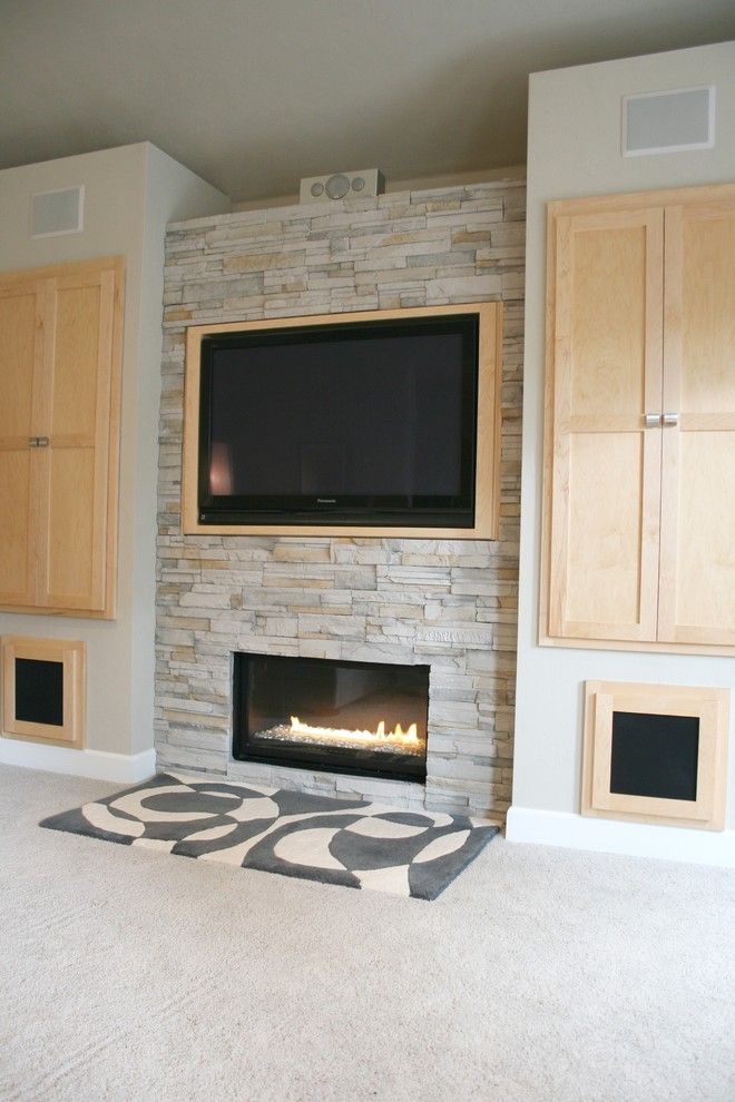Elk River Theater for a Modern Living Room with a Gray and Living Room + Fireplace + Built-in Cabinet Detail by Jordan Iverson Signature Homes